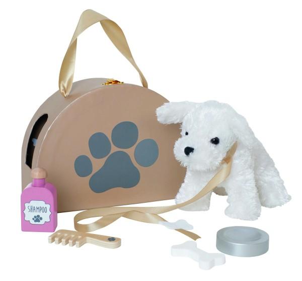 Petit chien avec son sac